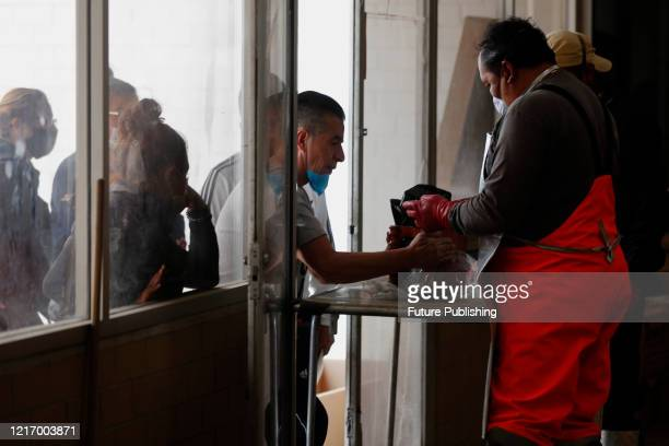 Crematorium worker of Nezahualcoyotl cemetery wears protective gear while delivery to relatives a urn of a person who died from COVID19 On June 2...