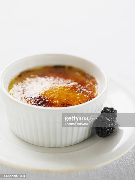 Creme brulee with organic blackberries, elevated view
