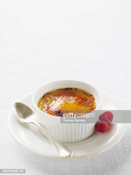 Creme brulee with organic raspberries, elevated view