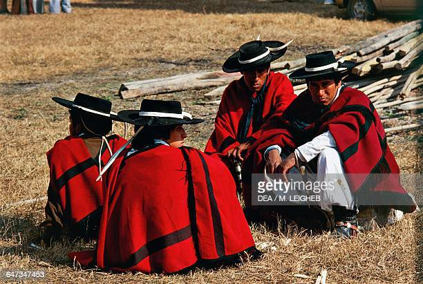 Creole gauchos wearing traditional clothes Argentina