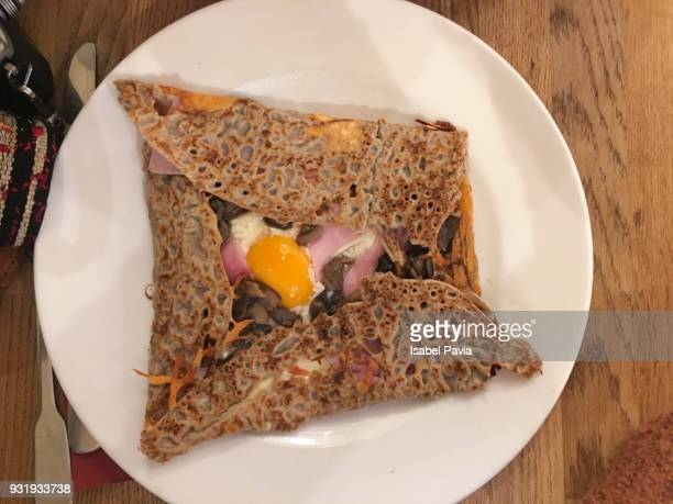 crepe with ham, cheese and egg - buckwheat stock pictures, royalty-free photos & images