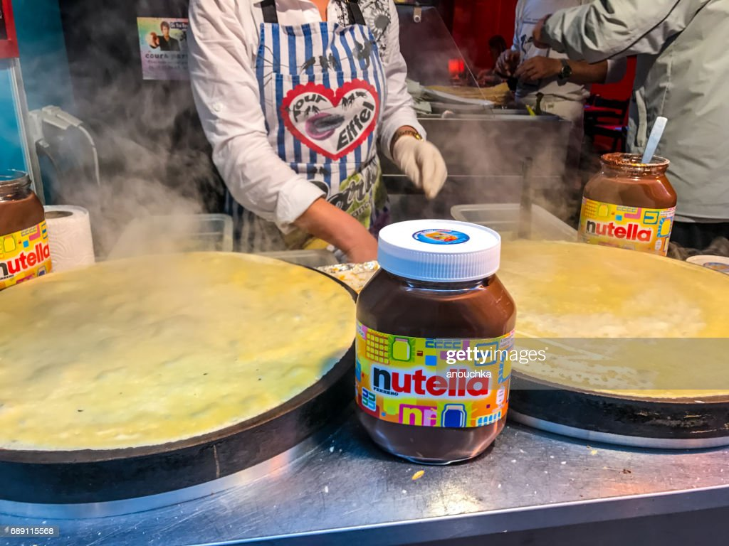 Crepes cooking outdoors in Paris, France : Stock Photo