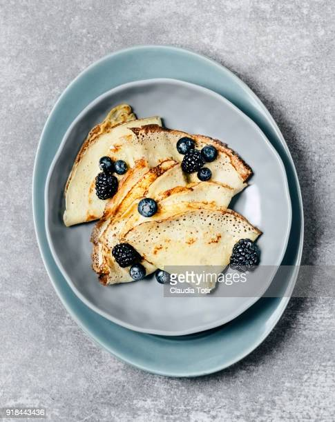 crepes with berries - pancake stock pictures, royalty-free photos & images