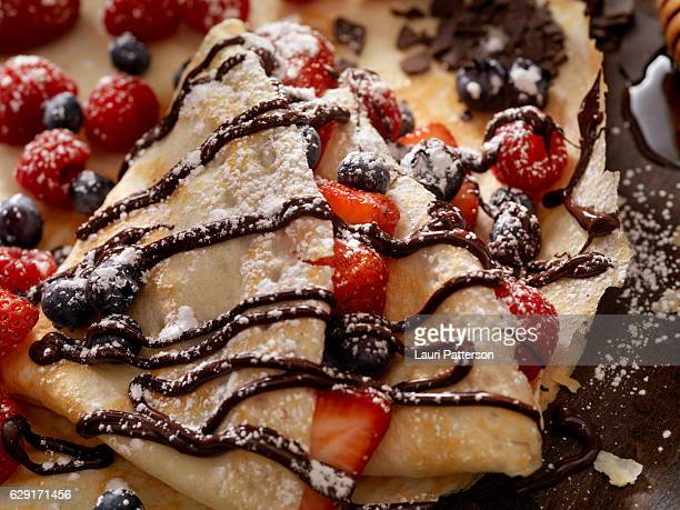 Crepes with Fresh Berries, Chocolate Sauce and Powdered sugar