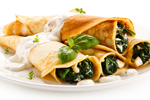 Crepes with spinach and cream 630069088