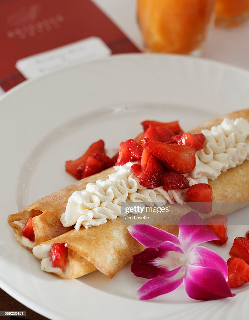 Crepes with strawberries : Stock Photo