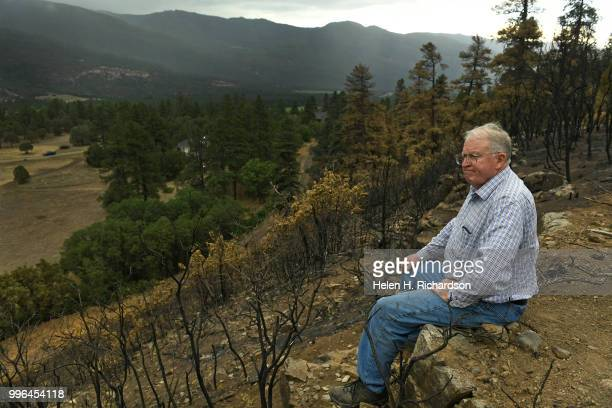 Cres Fleming sits at the top of the ridge above the train tracks in the exact area where he says the 416 fire started on July 10 2018 near Hermosa...