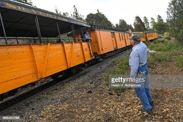 Cres Fleming with his dog Stella waves to conductor of the Durango Silverton Train as it makes its way towards Durango on July 10 trains that have...