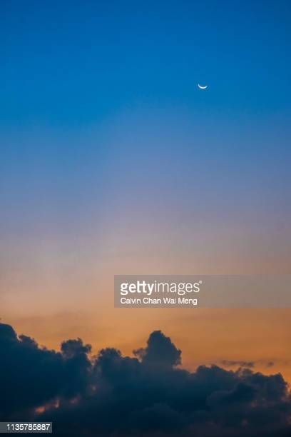 crescent moon and cloud during sunset - colorful sunset stock photos and pictures