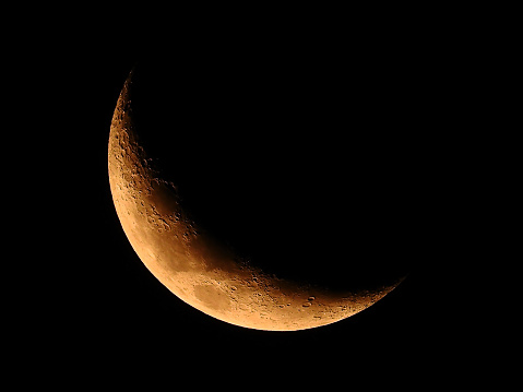crescent moon in night sky 930740202