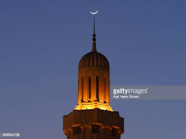 crescent moon over illuminated minaret, great sultan qabus mosque, muscat, oman - minaret stock pictures, royalty-free photos & images