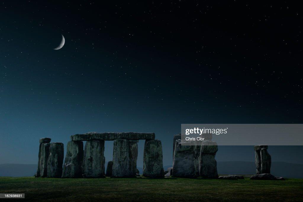 Crescent moon over Stonehenge monument, Wiltshire, United Kingdom : Stock Photo