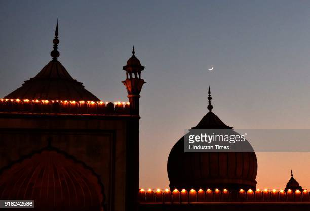Crescent moon over the Jama Masjid on the first day of the Islamic holy month of Ramadan on June 7 2016 in New Delhi India