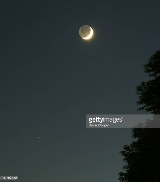 Crescent Moon with Earthshine taken at 928 pm Below is an orangecoloured Mars with Saturn to the lower right Photograph by Jamie Cooper