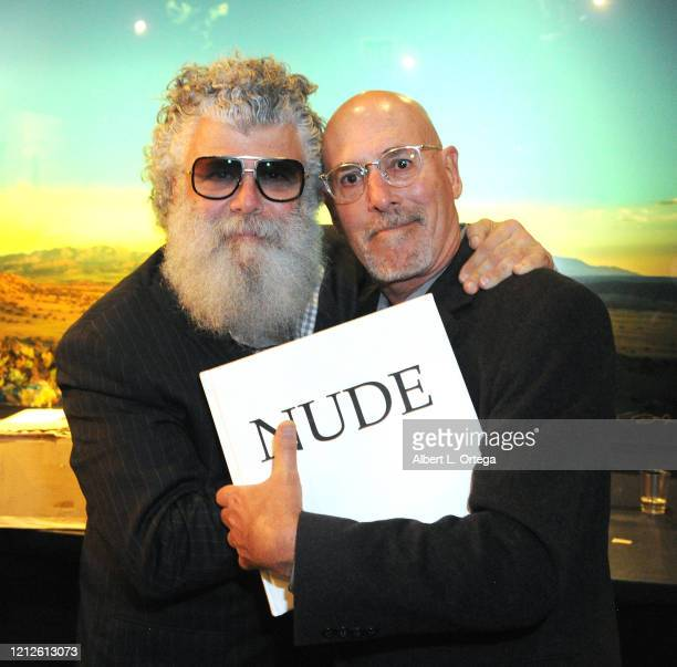 Crescenzo Giacomo poses for a picture with Daniel Pearl at the launch and signing for Crescenzo Notarile's book Nude held at Cinematic Pictures...