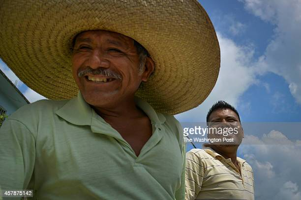 Cresencio Flores L and his son Javier Flores ride in the back of a truck to their lime fields near the village of La Mixtequita Mexico in Oaxaca...