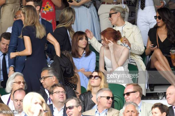 Cressida Bonas and Meghan Markle attend day eight of the Wimbledon Tennis Championships at Wimbledon on July 04 2016 in London England