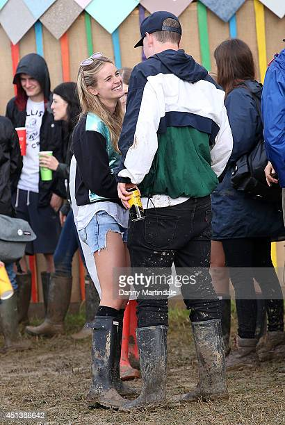 Cressida Bonas talks to actor Will Poulter at the Glastonbury Festival at Worthy Farm on June 28 2014 in Glastonbury England