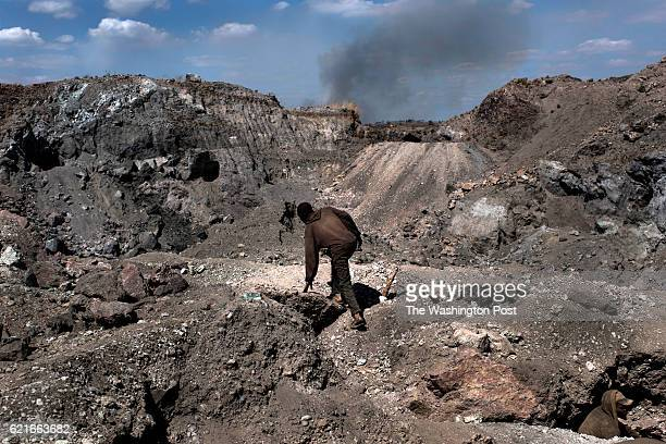 A creuseur or digger climbs through a copper and cobalt mine in Kawama Democratic Republic of Congo on June 8 2016 Cobalt is used in the batteries...
