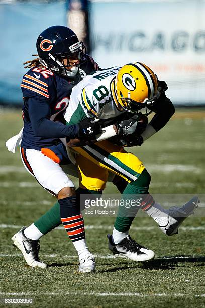 Cre'von LeBlanc of the Chicago Bears tackles Geronimo Allison of the Green Bay Packers in the first quarter at Soldier Field on December 18 2016 in...