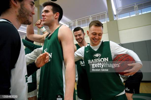 Crew Ainge son of Celtics president Danny Ainge right participates in practice for his Babson College basketball team in Wellesley MA on March 4 2020...