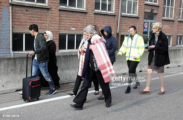 Crew and passengers are evacuated from Zaventem Bruxelles International Airport after terrorist attacks on March 22 2016 in Brussels Belgium At least...
