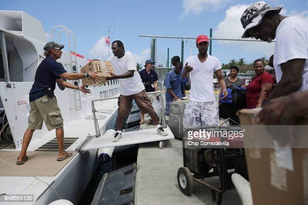 Crew and volunteers load the Queen Elizabeth IV ferry with supplies and passengers for St Thomas more than a week after Hurricane Irma made landfall...