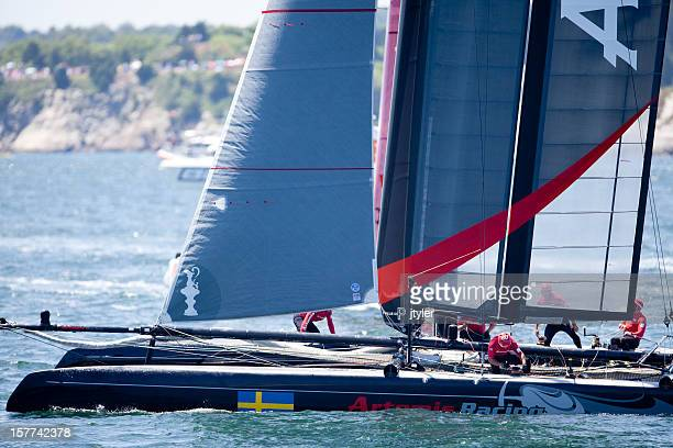 crew at work on catamaran racing yacht - catamaran race stock photos and pictures