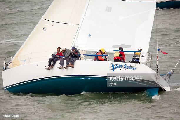 Crew Balancing a Cataline 34 Sailing Yacht