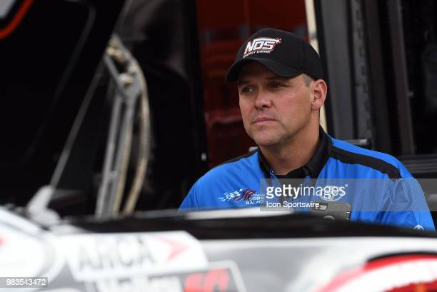 Crew Chief Bootie Barker looks on as his crew prepares the car of Riley Herbst Joe Gibbs Racing Toyota Camry before the start of practice for the...