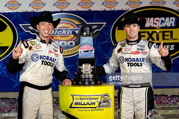Crew chief Chad Knaus and Jimmie Johnson driver of the Lowe's/Kobalt Chevrolet celebrates in victory lane after winning the NASCAR Nextel Cup Series...