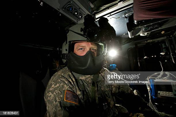 crew chief in a uh-60 black hawk helicopter. - inside helicopter stock pictures, royalty-free photos & images