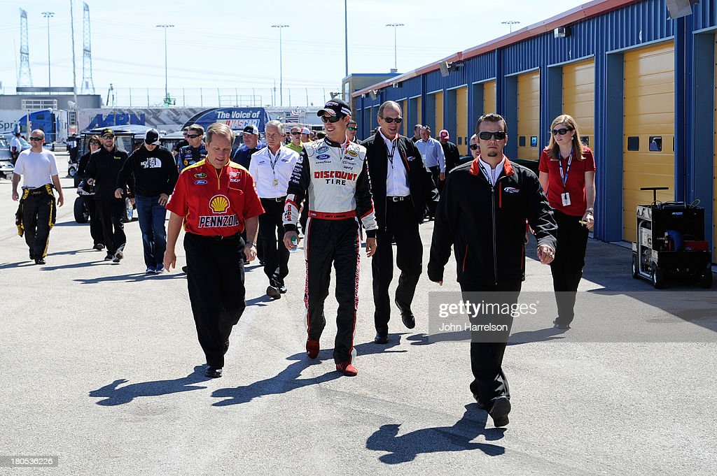 Crew chief Todd Gordon and Joey Logano, driver of the #22 Shell-Pennzoil Ford, walk out of a series-wide competition meeting before practice for the NASCAR Sprint Cup Series Geico 400 at Chicagoland Speedway on September 14, 2013 in Joliet, Illinois.
