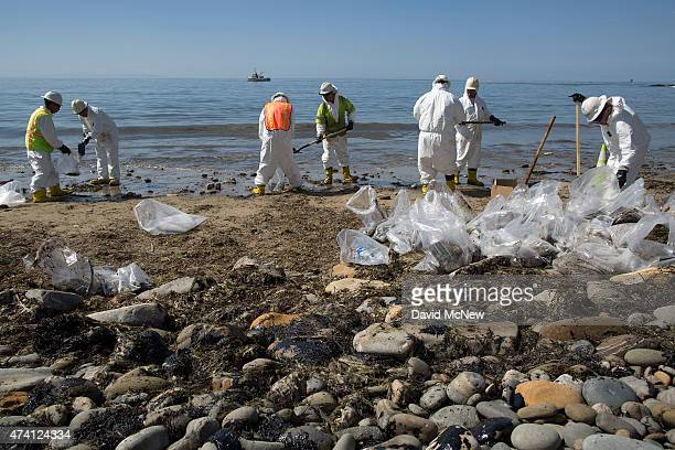 A crew cleans oil from the beach at Refugio State Beach on May 20 2015 north of Goleta California About 21000 gallons spilled from an abandoned...