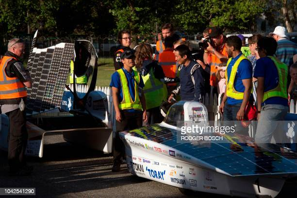 Crew crowd around the car of the team of Tokai University in Japan at the end of Day 7 of the Sasol Solar Challenge on September 28 in Swellendam...