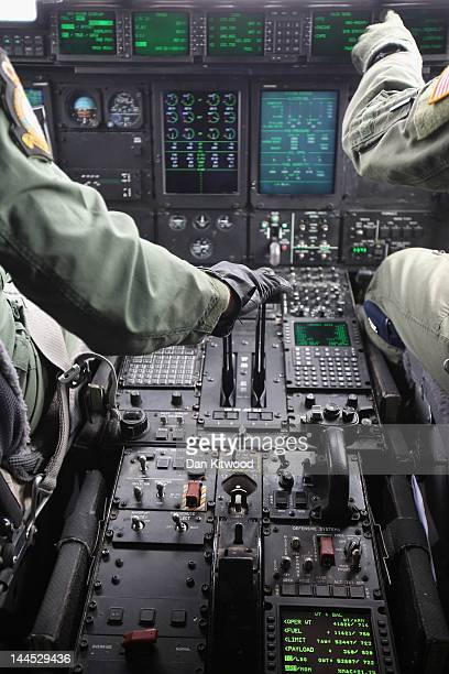 Crew fly an RAF Hercules C130 during a practice flight from RAF Brize Norton on May 15, 2012 in England. Two Hercules joined other aircraft to...
