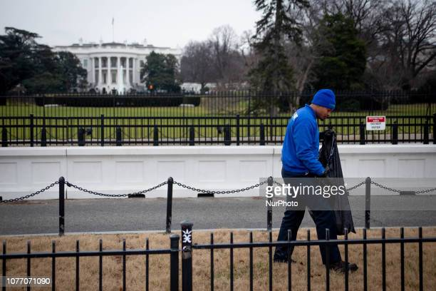 A crew from junk removal company 1800GotJunk clears garbage which has been uncollected due to the federal government shutdown from the Ellipse a...