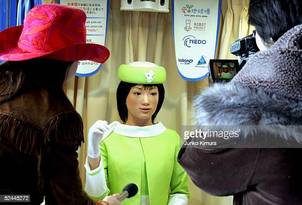 TV crew interview Kokoro's robot 'Actroid' during the press day of the Aichi World Exposition 2005 on March 18 2005 in Nagakute Japan Actrois is able...