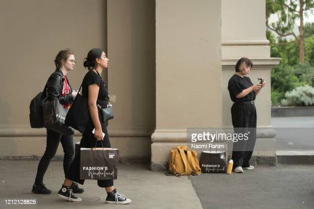 Crew leave the Royal Exhibition Building on March 13 2020 in Melbourne Australia Melbourne Fashion Festival organisers announced on Friday afternoon...