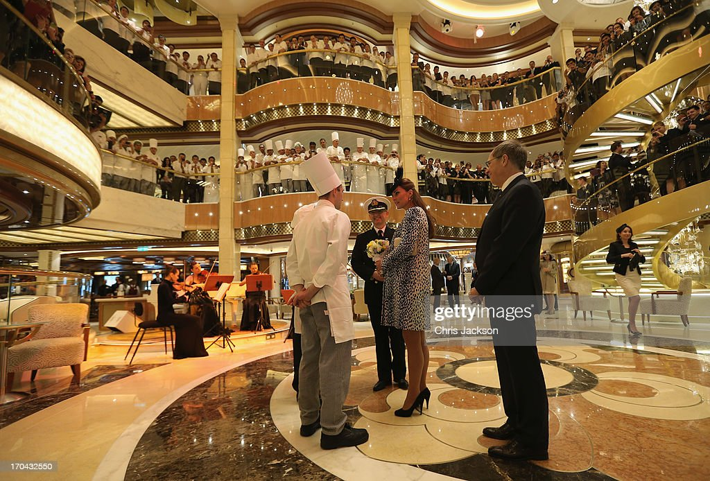 Crew look on as Captain Tony Draper (2nd-L) gives Catherine, Duchess of Cambridge a tour on board the Princess Cruises ship during its naming ceremony at Ocean Terminal on June 13, 2013 in Southampton, England.