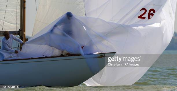 A crew member aboard Saskia struggles to untangle himself from the spinnaker which had been ripped by the sharp bow during racing at the Panerai...