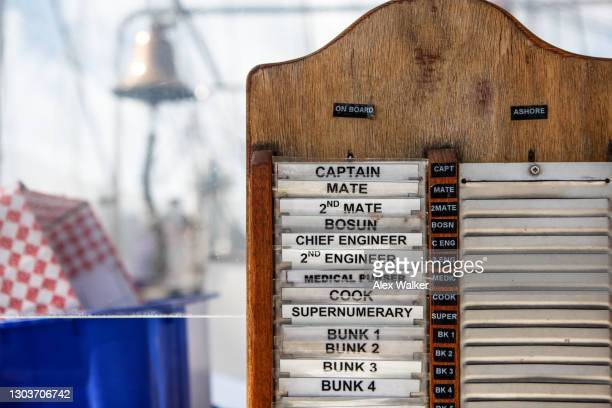 crew member board on a large sailing boat. - falmouth england stock pictures, royalty-free photos & images