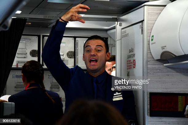 Crew member Carlos Ciuffardi talks to people on the plane moments after being married by Pope Francis with also crew member Paula Podest during the...