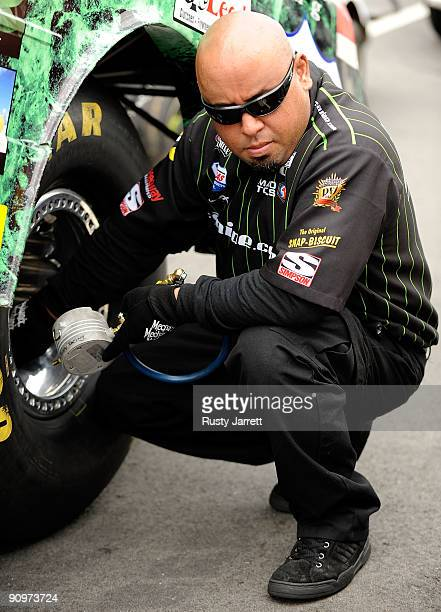 A crew member checks a tire during qualifying for the NHRA Carolinas Nationals on September 19 2009 at Zmax Dragway in Concord North Carolina