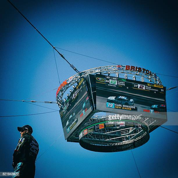 A crew member for Kasey Kahne driver of the Great Clips Chevrolet stands on top of a hauler during the NASCAR Sprint Cup Series Food City 500 at...