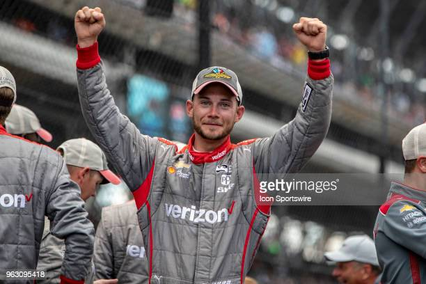 Crew member for Will Power driver of the Team Penske Chevrolet raises his hands in celebration after winning the running of the 102nd Indianapolis...