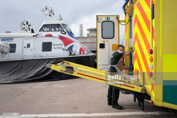 Crew member from South Central Ambulance Service, operated by South Central Ambulance Service NHS Foundation Trust, loads a patient into an ambulance...