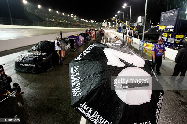 Crew member Gwynn Havens, of Madison, North carolina, waits for the official call for the Dodge Avenger 500 to be postponed until 1 p.m. Sunday, May...