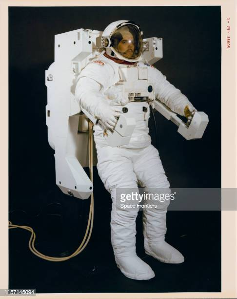 A crew member in a mockup of the Space Shuttle Extravehicular Mobility Unit and Manned Maneuvering Unit the NASA astronaut propulsion unit 17th...