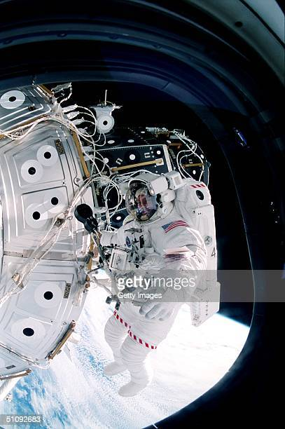 Crew Member Inside The ShirtSleeve Environment Of The Space Shuttle Discovery Snapped This 35Mm Frame Of Astronaut Michael LopezAlegria October 15...